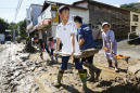 The Latest: Typhoon leaves up to 33 dead in Japan