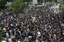 Hong Kong protesters hurl objects at police station