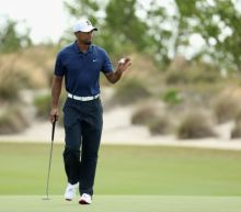 Tiger Woods wasted little time switching back to his Scotty Cameron putter