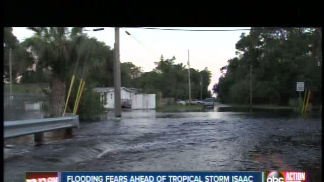 Despite flooded streets, Neighbors won't flee Isaac