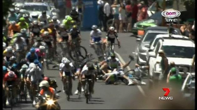 Greipel avoids crash to make history