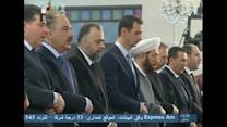 Assad prays as war rages across Syria