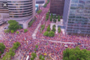 Trump supporters post fake photos of huge crowds at Phoenix rally - as real images show room half-empty