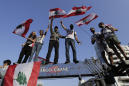 Lebanese protesters dig in, even after proposed reforms