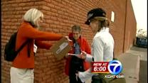 Volunteers collect signatures for tougher gun laws