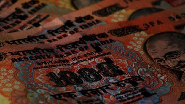 Rupee down 20 paisa to USD in early trade