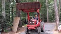 Man Dares Ice Bucket Challenge With a Tractor