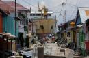 Tsunami and quake survivors eat last bit of food and seethe